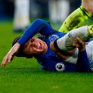 Everton's James McCarthy reacts after sustaining an injury in a challenge with West Bromwich Albion's Salomon Rondon