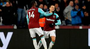 West Ham United's Javier Hernandez celebrates scoring their equaliser with Pedro Obiang