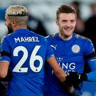 Leicester City's Jamie Vardy and Riyad Mahrez celebrate after the match