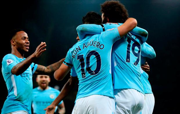 Manchester City's Sergio Aguero (centre) celebrates scoring his side's third goal