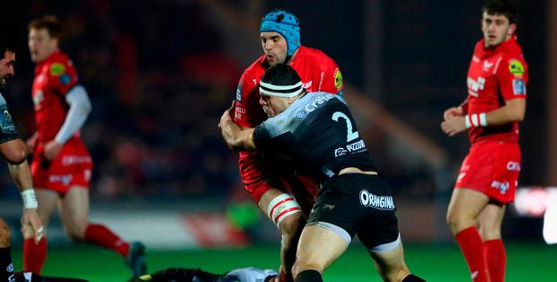 Tadhg Beirne of Scarlets is held up by Guilhem Guirado of Toulon during the European Rugby Champions Cup match between Scarlets and RC Toulon at Parc y Scarlets