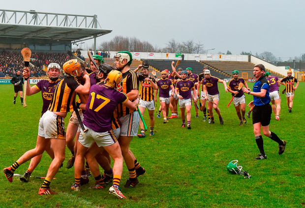 Kilkenny and Wexford players tussle during the Bord na Mona Walsh Cup final in Nowlan Park yesterday. Photo: Matt Browne/Sportsfile