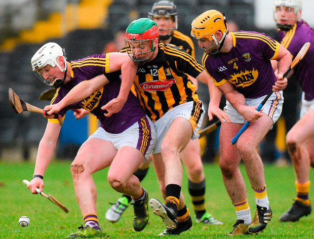 Aaron Maddock, left, and Eoin Moore of Wexford in action against Pat Lyng of Kilkenny during the Bord na Mona Walsh Cup Final. Photo: Matt Browne/Sportsfile