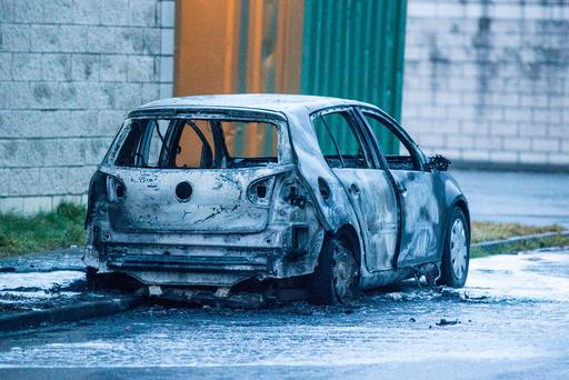 The burned out shell of the VW Golf believed to have been used by the killers. Pic: Mark Condren