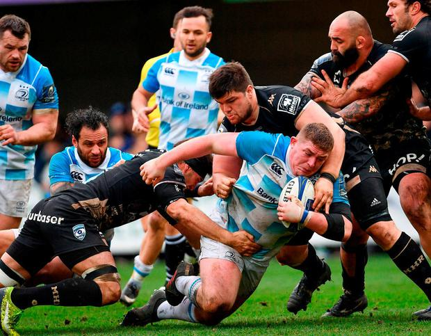 Tadhg Furlong is tackled by Kelian Galletier (l) and Antoine Guillamon of Montpellier at the Altrad Stadium. Photo: Ramsey Cardy