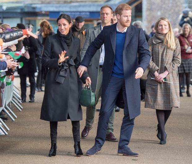 Loved up: Harry and Meghan in Wales last week, where she paired a £1,350 Stella McCartney coat with £175 black skinny jeans by Welsh brand Hiut Denim