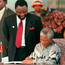 In this picture from 1996, then South African president Nelson Mandela signs the country's new constitution while Cyril Ramaphosa, the ANC's chief negotiator during the drafting process, looks on. Ramaphosa now leads the ANC and is set to be South Africa's next president. Photo: AFP