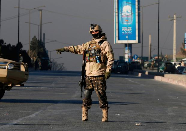 An Afghan security force personnel keeps watch close to the entrance gate of Kabul's Intercontinental Hotel during an attack by gunmen in Kabul, Afghanistan. January 21, 2018.REUTERS/Omar Sobhani
