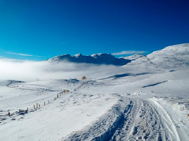Cloud inversion above Kingussie in the Scottish Highlands, as motorists are being urged to be wary of ice on the roads after disruption in areas hit by snow this week. Catriona Webster/PA Wire