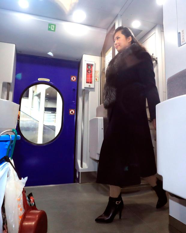 Hyon Song Wol, head of the North Korea's Samjiyon Orchestra, gets on a KTX train as she departs for Gangneung at a railway station in Seoul, South Korea, January 21, 2017. Shin Joon-hee/Yonhap via REUTERS