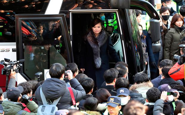 North Korean Hyon Song Wol, head of a North Korean art troupe, gets off a bus as she arrives at the Seoul Train Station in Seoul, South Korea, Sunday, Jan. 21, 2018. (Kim Sun-ung/Newsis via AP)