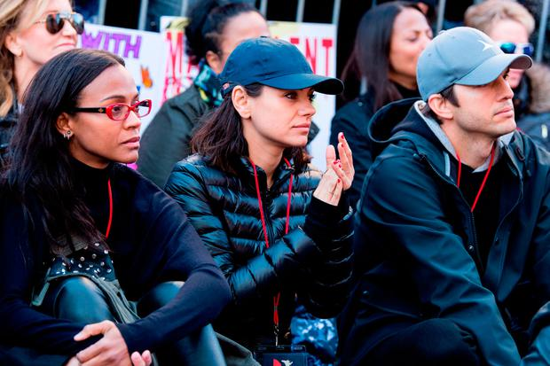 Zoe Saldana, Mila Kunis, and Ashton Kutcher attend the women's march Los Angeles on January 20, 2018 in Los Angeles, California. (Photo by Emma McIntyre/Getty Images)
