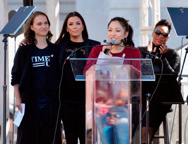 (L-R) Actors Natalie Portman, Eva Longoria and Constance Wu speak during the Women's March Los Angeles 2018 on January 20, 2018 in Los Angeles, California. (Photo by Chelsea Guglielmino/Getty Images)