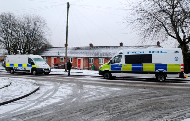 Police tape around a property in Brownhills, near Walsall, where a child was discovered seriously wounded on Saturday night and died a short time later in hospital. Matthew Cooper/PA Wire