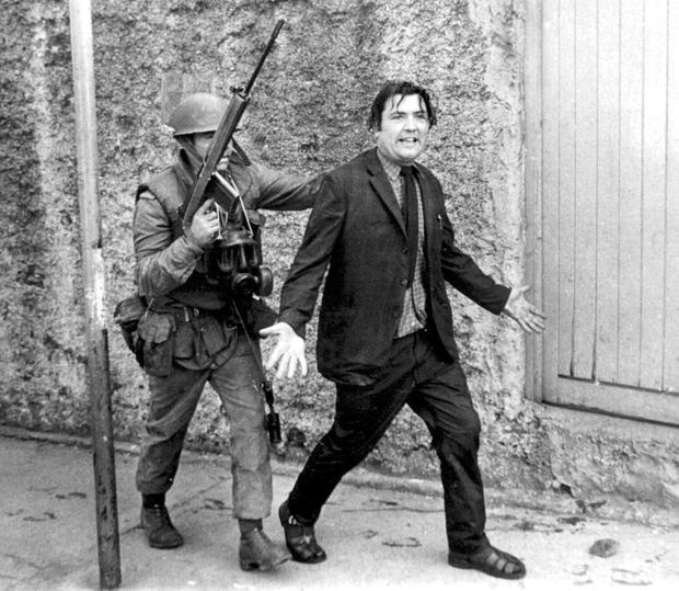 Peacemaker John Hume is escorted away by a British soldier during a civil rights demonstration in Derry in 1971