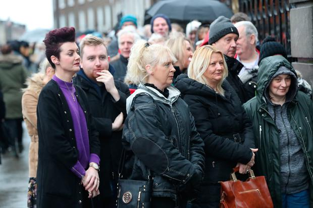 People queue as the coffin of Cranberries singer Dolores O'Riordan arrives at St Joseph's Church in Limerick, Ireland, for a public reposal. Photo: Niall Carson/PA Wire