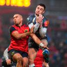 Simon Zebo of Munster in action agaisnst Geoffrey Palis of Castres during the European Rugby Champions Cup Pool 4 Round 6 match between Munster and Castres at Thomond Park in Limerick. Photo by Diarmuid Greene/Sportsfile