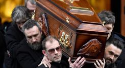 The coffin of Dolores O'Riordan, singer with the Cranberries is carried from St. Joseph's Church after a public reposal in Limerick, Ireland January 21, 2017. REUTERS/Clodagh Kilcoyne
