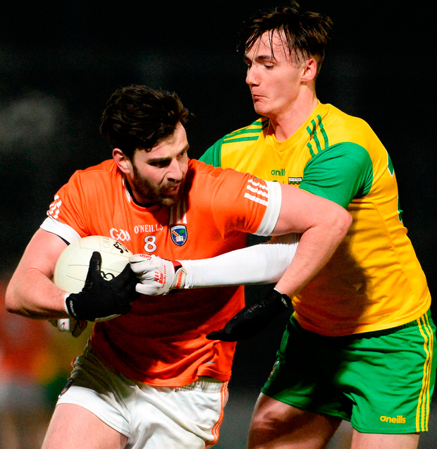 Aaron Findon of Armagh in action against Jason McGee of Donegal. Photo by Oliver McVeigh/Sportsfile