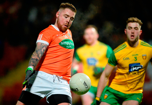 Eamon McGeown of Armagh in action against Stephen McMenamin of Donegal. Photo by Oliver McVeigh/Sportsfile