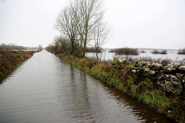 Roads throughout Galway are flooded after heavy rainfall yesterday and farmers are on standby to face more problems as rain continues Photo: Hany Marzouk