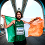 Mick Clohisey draped in the Irish flag on London's Tower Bridge after the marathon at last year's World Championships.