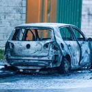 A burnt out car at Station Road Business Park after the shooting at Bridgeview halting site. Photo: Mark Condren