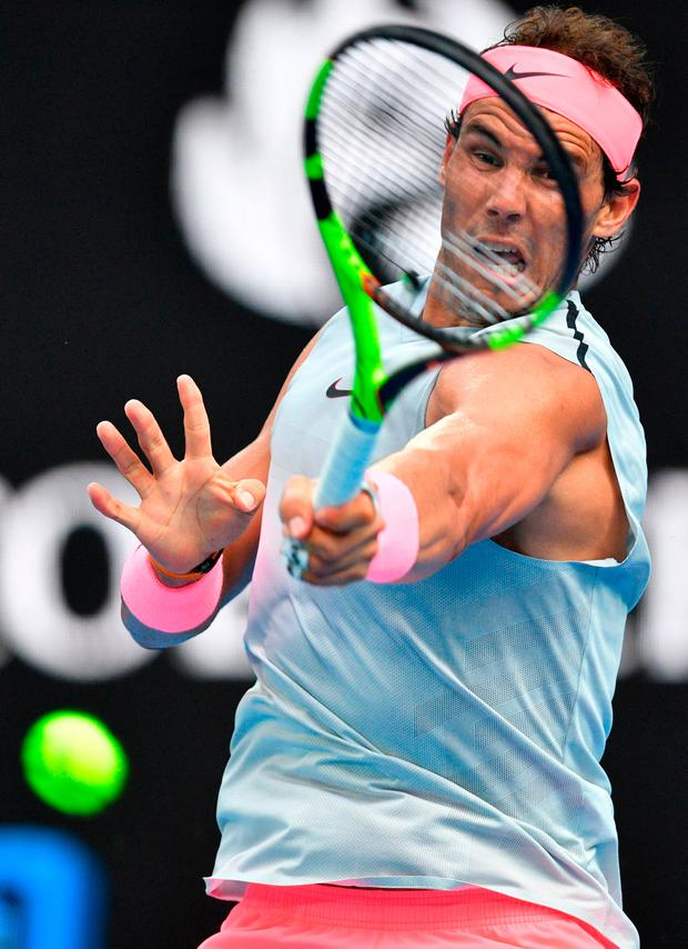 Rafael Nadal hits a return against Diego Schwartzman during their fourth-round match at the Australian Open. Photo: Getty Images