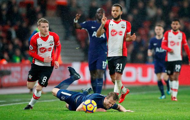 Southampton's Steven Davis and Ryan Bertrand in action with Tottenham's Harry Kane. Photo: Reuters/David Klein