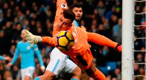Sergio Aguero beats Newcastle goalkeeper Karl Darlow with the faintest of touches to score Manchester City's first goal. Photo by Stu Forster/Getty Images