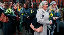 Mourners, many in tears, queue to pay their respects to Dolores O'Riordan at St Joseph's Church. Photo: PA