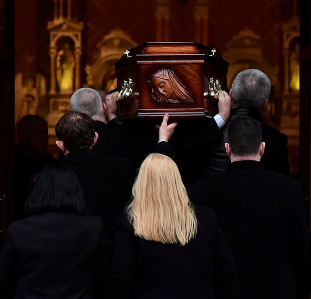 The mother of Cranberries singer Dolores O'Riordan, Eileen O'Riordan follows her daughter's coffin into St. Joseph's Church for a public reposal in Limerick. REUTERS/Clodagh Kilcoyne