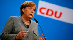 German Chancellor Angela Merkel gives a statement at the CDU headquarters in Berlin after Germany's Social Democrats (SPD) voted to begin formal coalition talks with Chancellor Merkel's conservatives. REUTERS/Axel Schmidt