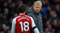 Arsene Wenger watches Nacho Monreal leave the pitch during their victory over Crystal Palacemidfield Photo: Reuters
