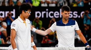 Tennis - Australian Open - Rod Laver Arena, Melbourne, Australia, January 22, 2018. South Korea's Chung Hyeon with Serbia's Novak Djokovic after Chung Hyeon wins the match. REUTERS/Edgar Su