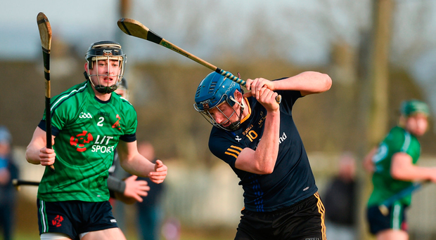 John Donnelly of DCU in action against LIT's Eoin Quilty Photo: Diarmuid Greene/Sportsfile