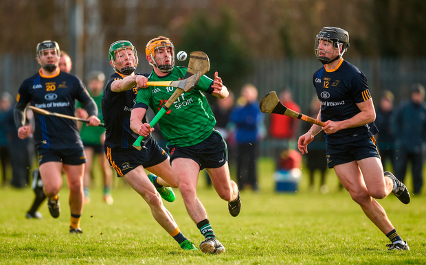 David Conroy of LIT in action against Fergal Whitely (left) and Donal Burke of DCU Photo: Diarmuid Greene/Sportsfile