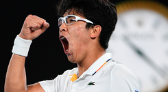 Hyeon Chung celebrates after winning a point on his way to beating Novak Djokovic in straight sets. Photo: Getty Images