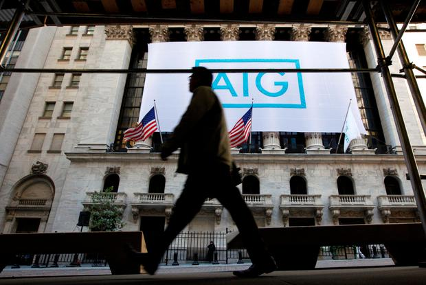 A banner for American International Group Inc (AIG) hangs on the facade of the New York Stock Exchange