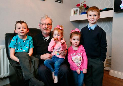 Michael Reilly with his grandchildren Jay (6), Kylie (2), Amelia (3) and Lewis (7) at his home in Dublin. Photo: Frank McGrath