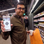 Amazon employee Krishna Iyer shows off an Amazon Go app as he shops in the store. Photo: AP