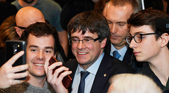 Ousted Catalan leader Carles Puigdemont, centre, poses for selfies at a debate in Copenhagen yesterday. Photo: AP