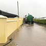 A slurry tanker helps drain flood water. Picture: Peter Ormond