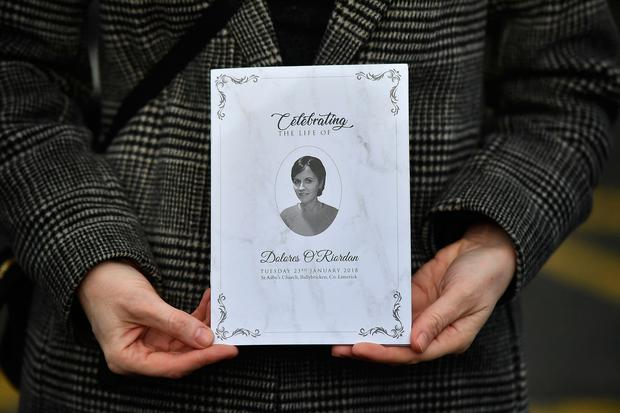 A member of the congregation holds up an order of service ahead of Dolores O'Riordan's funeral (Photo by Charles McQuillan/Getty Images)