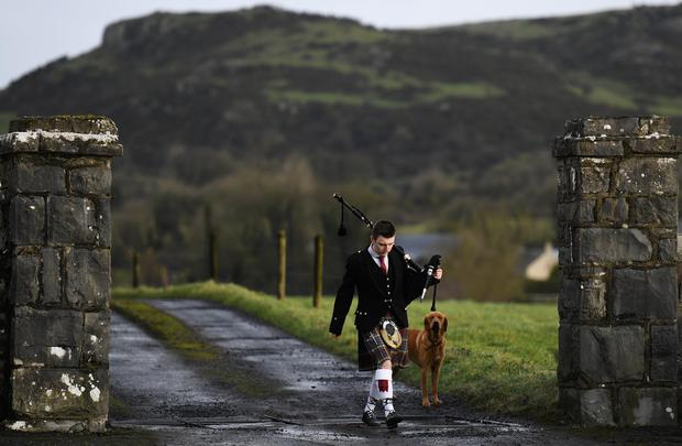 A piper arrives at Dolores O'Riordan, the singer of the Cranberries' funeral at St Ailbe's Churc REUTERS/Clodagh Kilcoyne