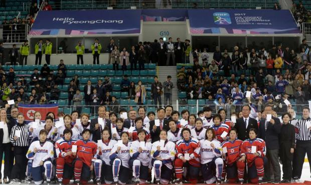 The IOC confirmed last week that 12 North Korean players would join the South's 23-player squad during the upcoming Games. CREDIT: AP