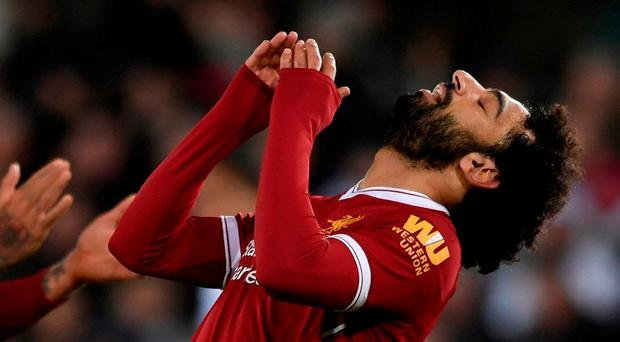 Mohamed Salah reacts after a missed chance last night