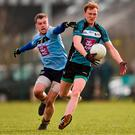 Paul Cribben of Maynooth University in action against Eoin Lowry of University College Dublin during the Electric Ireland HE GAA Sigerson Cup Round 1 match between Maynooth University and University College Dublin at Maynooth University North Campus in Maynooth, Kildare. Photo by Seb Daly/Sportsfile