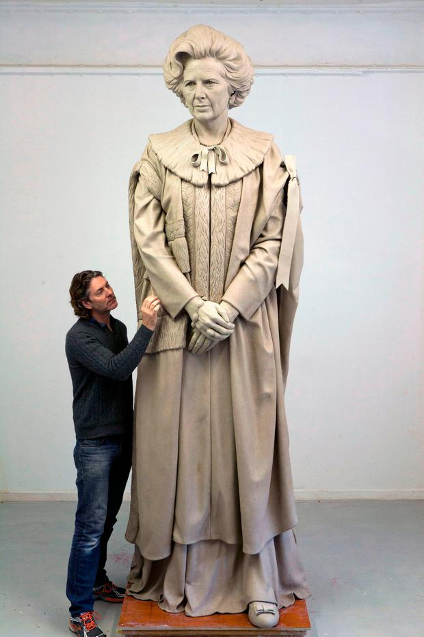 Undated handout file photo issued by Fine Architecture of sculptor Douglas Jennings working on his statue of Margaret Thatcher, as proposals for a statue of the former prime minister in Parliament Square look set to be rejected because there are too many monuments in the area.
