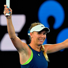 Caroline Wozniacki celebrates after beating Carla Suarez Navarro in their women's singles quarter-final. Photo: Getty Images